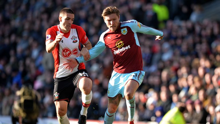 BURNLEY, ENGLAND - FEBRUARY 24:  Jeff Hendrick of Burnley is challenged by Oriol Romeu of Southampton during the Premier League match between Burnley and S