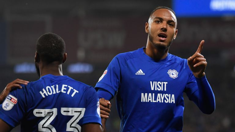 CARDIFF, WALES - SEPTEMBER 26:  Cardiff player Kenneth Zohore (r) celebrates his first goal with an assist from Junior Hoilett during the Sky Bet Champions