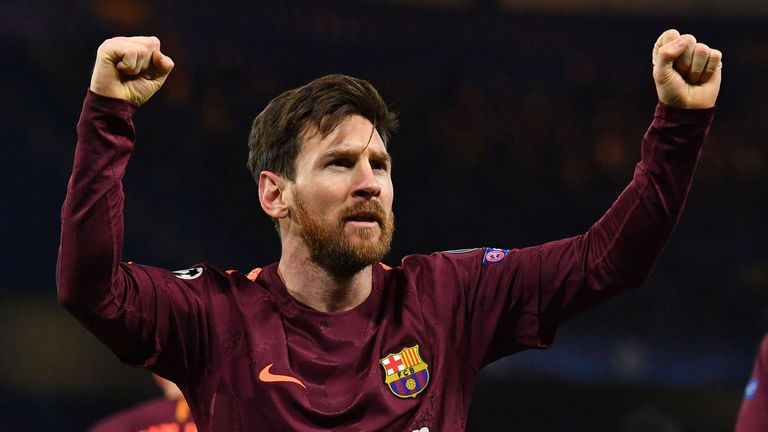 Barcelona's Argentinian striker Lionel Messi celebrates after scoring their first goal during the first leg of the UEFA Champions League round of 16 footba