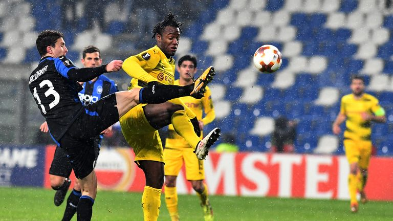 Atalanta's defender from Italy Mattia Caldara (L) fights for the ball with  Borussia Dortmund's forward from Belgium Michy Batshuayi during the round of 32