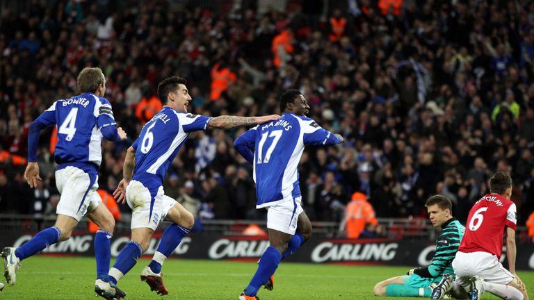 Birmingham City's Obafemi Martins (C) celebrates with teammates English midfielder Lee Bowyer (L) and Birmingham City's English defender Liam Ridgewell (2n