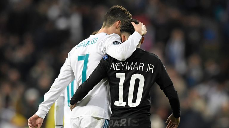 Real Madrid's Portuguese forward Cristiano Ronaldo (L) and Paris Saint-Germain's Brazilian forward Neymar leave the pitch at half-time during the UEFA Cham