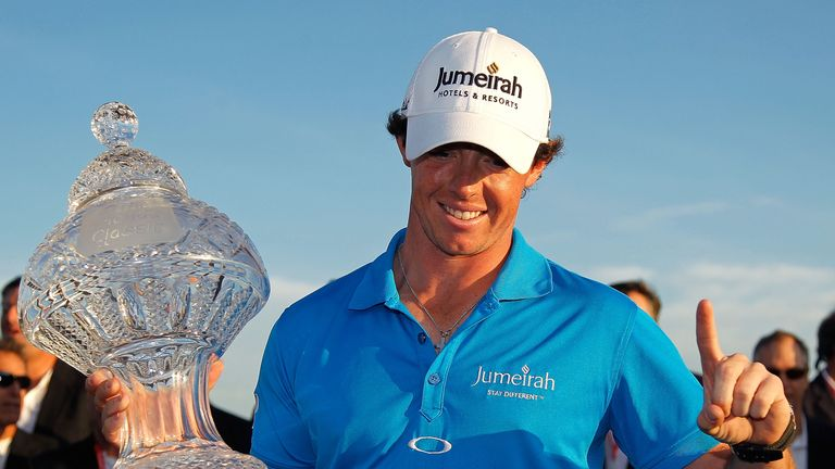 PALM BEACH GARDENS, FL - MARCH 04:  Rory McIlroy of Northern Ireland poses with the trophy after winning the Honda Classic at PGA National on March 4, 2012
