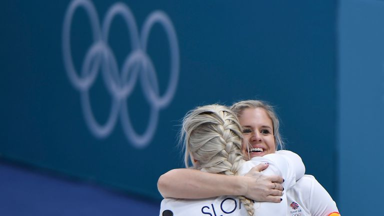 Britain's Vicki Adams celebtates with Anna Sloan after winning the curling women's round robin session between Canada and Britain during the Pyeongchang 20