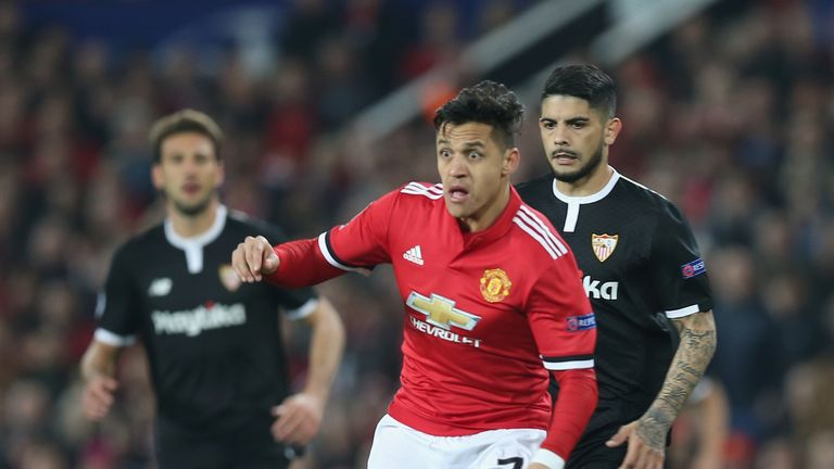 Alexis Sanchez in possession at Old Trafford in the first half