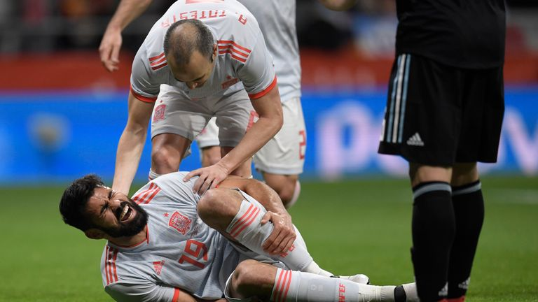 Diego Costa reacts in agony after his brave goal put Spain ahead in Madrid