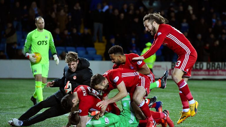 Aberdeen players celebrate their shootout win