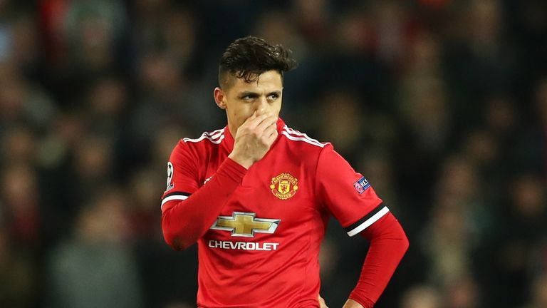 Alexis Sanchez looks disconsolate during United's defeat to Sevilla on Tuesday night