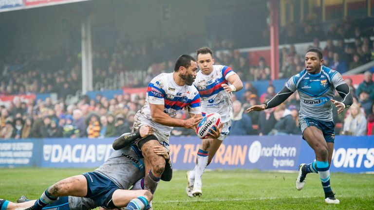 Wakefield's Bill Tupou is tackled as he offloads to Mason Caton-Brown