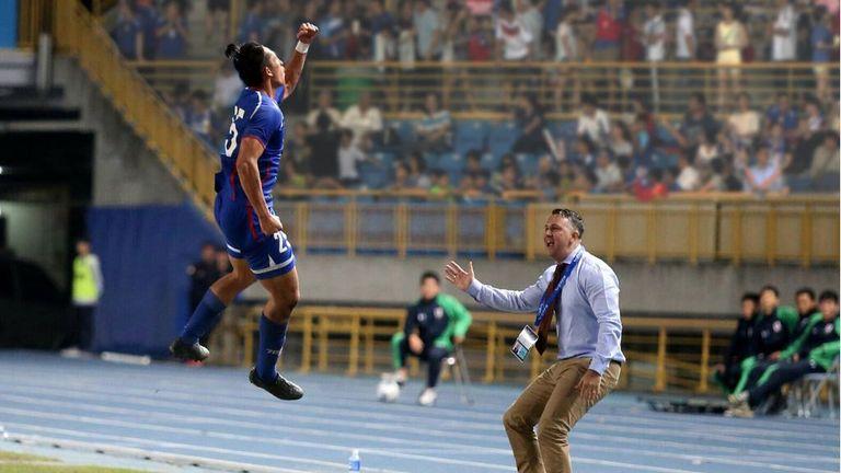 Chinese Taipei coach Gary White celebrates with his players [Credit: CTFA]