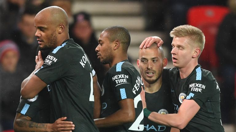David Silva (centre) is congratulated by his Man City team-mates after opening the scoring against Stoke