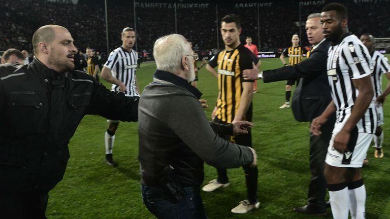 Greek derby postponed as enraged PAOK owner charges onto pitch with gun