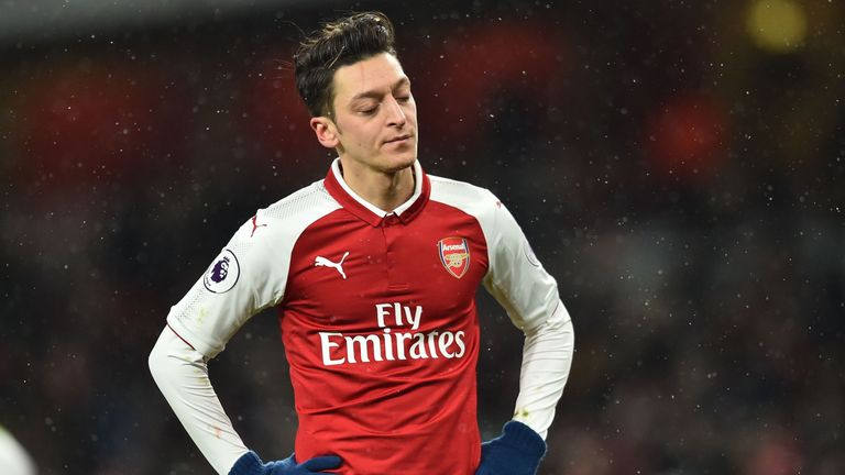 Mesut Ozil looks on during the home defeat to Manchester City