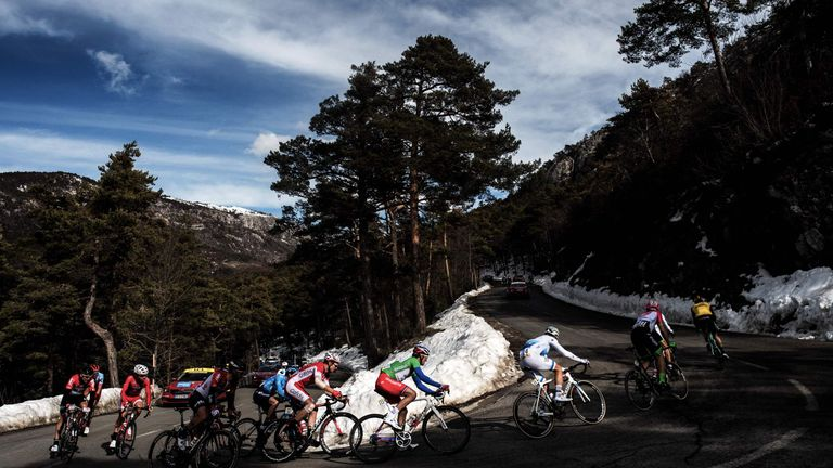 Cyclists ride in a breakaway past snow during the seventh stage of the Paris- Nice cycling race between Sisteron and Vence