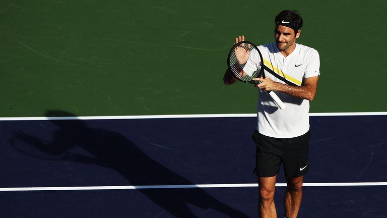 Roger Federer celebrates after beating Federico Delbonis