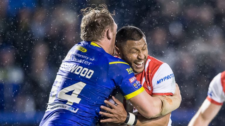 St Helens' Dominique Peyroux is tackled by Warrington's Ben Westwood