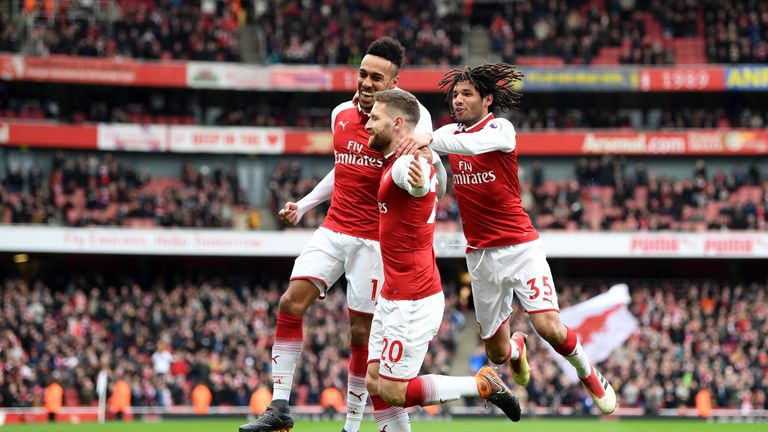 Shkodran Mustafi celebrates scoring Arsenal's first goal against Watford with Pierre-Emerick Aubameyang and Mohamed Elneny