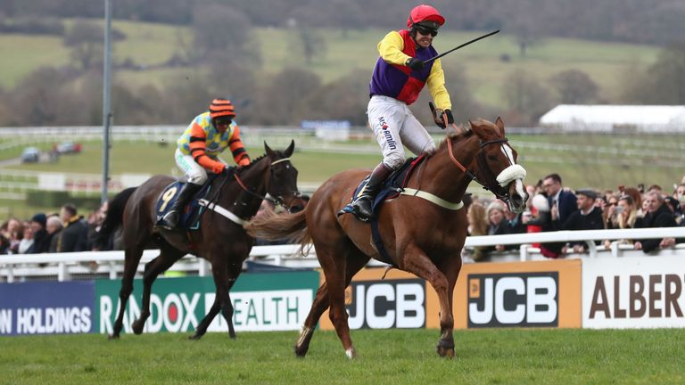 Richard Johnson celebrates as Native River beats Might Bite in the Timico Cheltenham Gold Cup