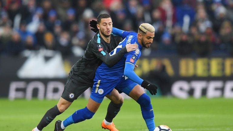 Riyad Mahrez of Leicester City holds off Eden Hazard of Chelsea during The Emirates FA Cup Quarter Final match at The King Power Stadium on March 18, 2018 in Leicester, England