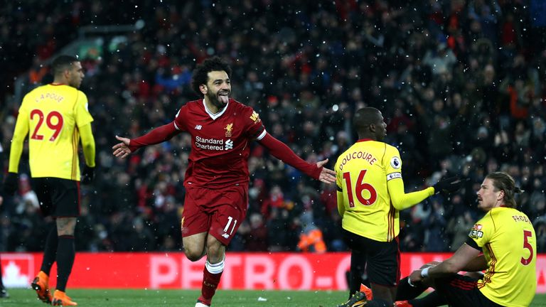 Mohamed Salah celebrates completing his hat-trick against Watford