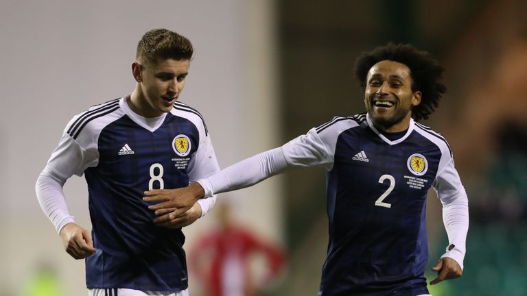 EDINBURGH, SCOTLAND - MARCH 22:  Tom Cairney and Ikechi Anya of Scotland celebrates scotlands' only goal during the International Challenge Match between Scotland and Canada at Easter Road on March 22, 2017 in Edinburgh, Scotland. (Photo by Ian MacNicol/Getty Images)