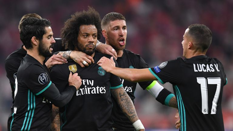 Marcelo (centre) is congratulated by team-mates after equalising for Real Madrid in the first leg