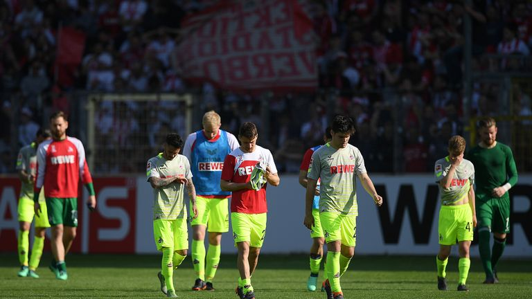 Cologne players leave the field at Freiburg dejected after being relegated