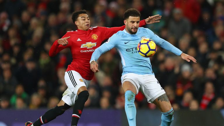 Man City's Kyle Walker holds off the challenge of Man Utd's Jesse Lingard
