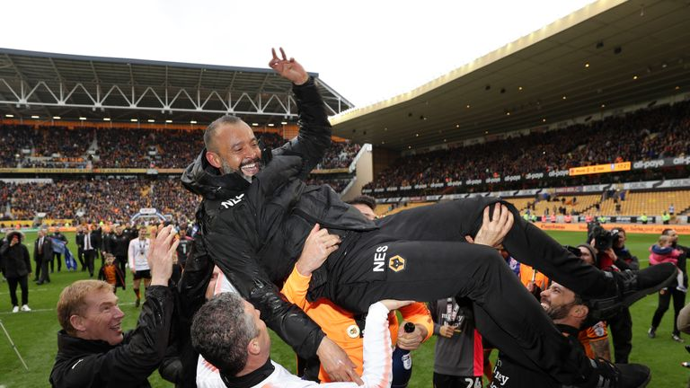 Nuno Espírito Santo is carried across the pitch during celebrations at Molineux