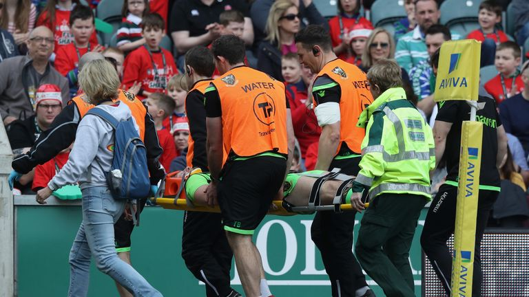 Rob Horne is stretched off in a neck brace at Welford Road