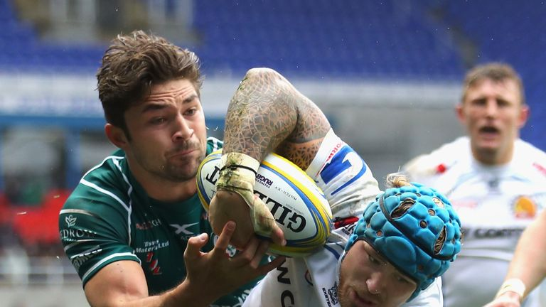 Jack Nowell looks to keep hold of possession after a tackle by Tom Fowlie