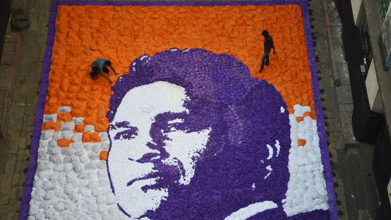 Artists work on an image of Sachin Tendulkar to celebrate his  45th birthday (Credit: AFP)