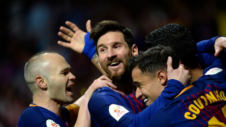 Lionel Messi is mobbed by team-mates after putting Barcelona 2-0 ahead
