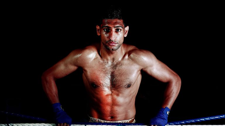 Amir Khan poses during a photo shoot at Gloves Gym on April 22, 2013 in Bolton, England. *** Local Caption *** Amir Khan