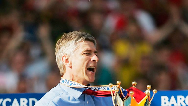 Arsene Wenger lifts the Barclaycard Premiership trophy during the after the match between Arsenal and Leicester City at Highbury on May 15, 2004