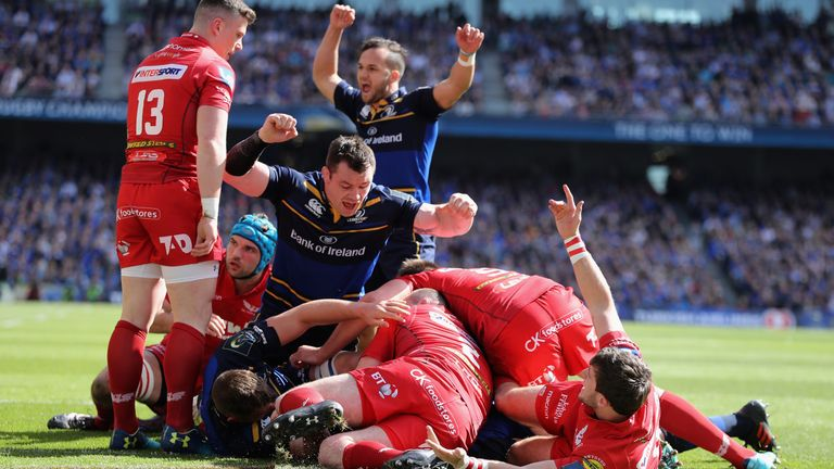 Leinster's Jamison Gibson-Park celebrates as James Ryan dives over for the first try against Scarlets