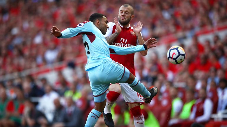 Aaron Lennon collides with Jack Wilshere in the first half