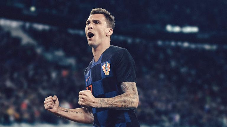 Mario Mandzukic sports Croatia's away shirt which combines black and blue checkerboard