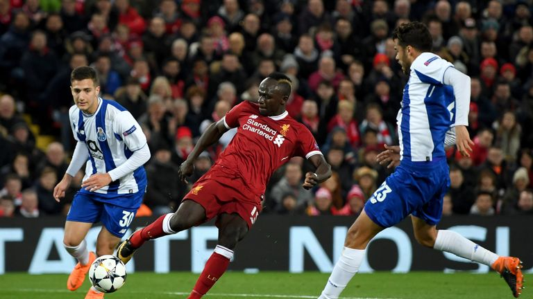 Sadio Mane shoots under pressure from Diogo Dalot (L) and Diego Reyes Liverpool's Champions League last-16 second leg with Porto