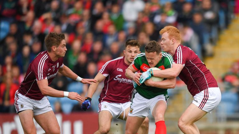 Andy Moran batles with three Galway players.