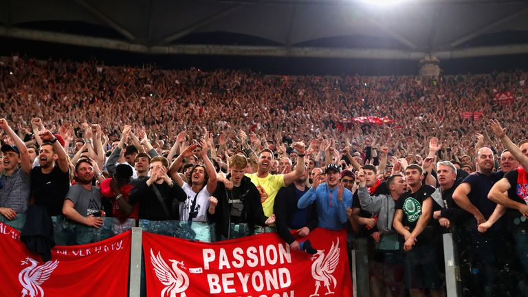 Liverpool fans celebrate the victory in Rome