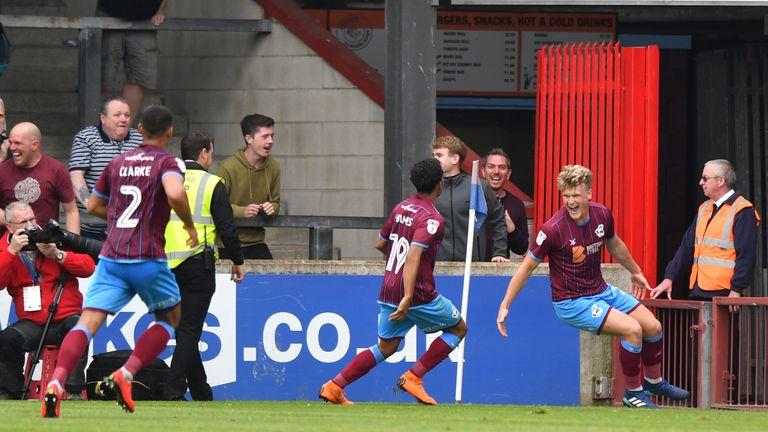 Scunthorpe United's Cameron McGeehan (right) celebrates scoring the equaliser against Rotherham