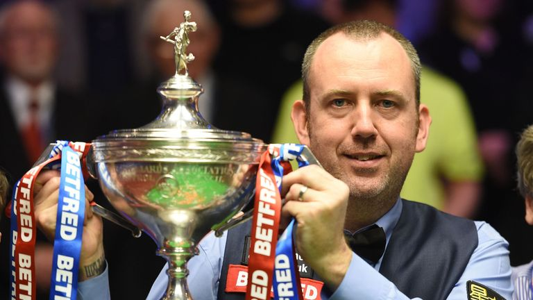 Mark Williams celebrates with the World Snooker Championship trophy