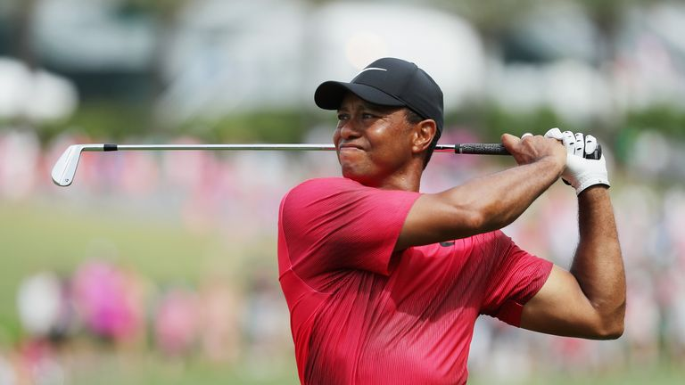 Woods was six under for the day after 12 holes