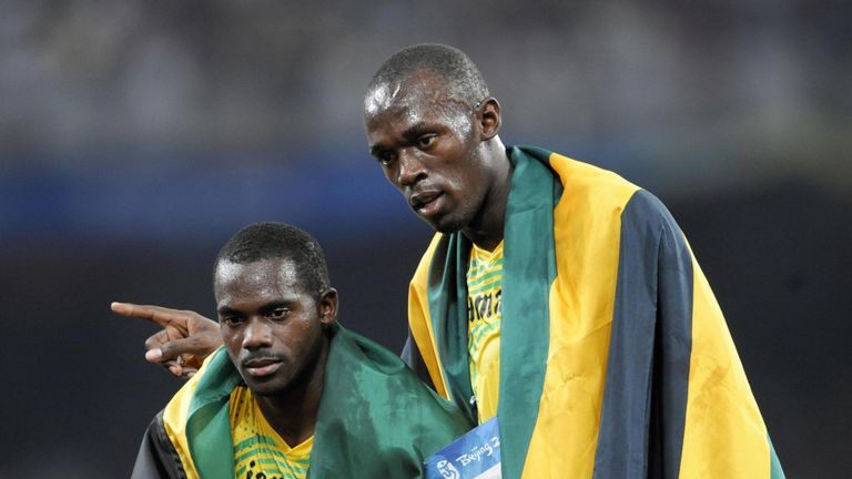 Carter with Bolt following the 4x100 relay in 2008