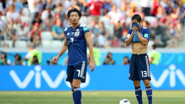 Japan players react after conceding against Poland