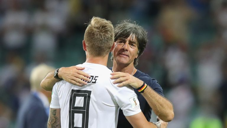 Germany coach Joachim Low hugs match-winner Kroos
