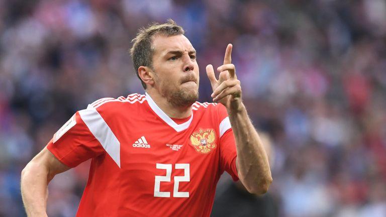 Artem Dzyuba celebrates after scoring Russia's third goal
