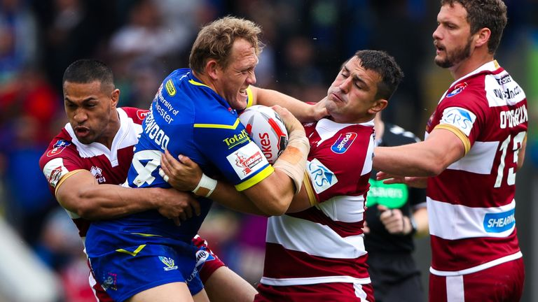 Warrington's Ben Westwood was the victim of a questionnable tackle attempt by Wigan's Thomas Leuluai during their quarter-final clash