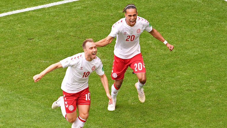 Christian Eriksen celebrates with Denmark's Yussuf Poulsen